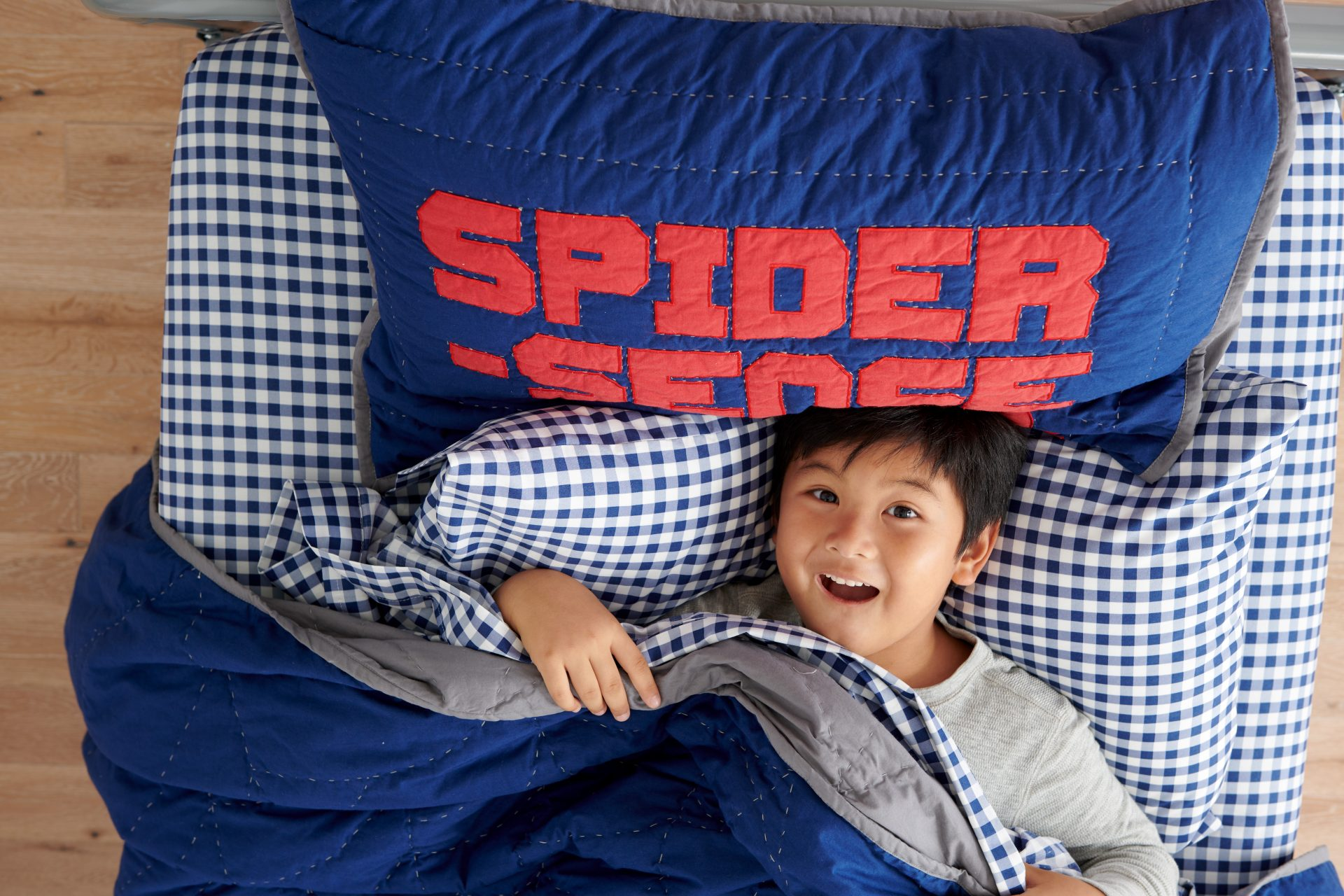 boy in spider sense bedding